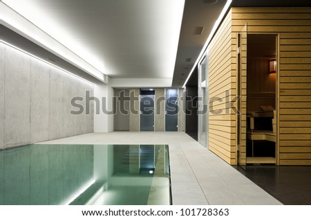 modern concrete house , indoor pool with sauna - stock photo