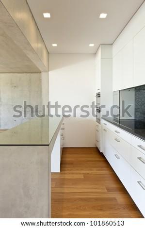 modern concrete house , kitchen, concrete table - stock photo