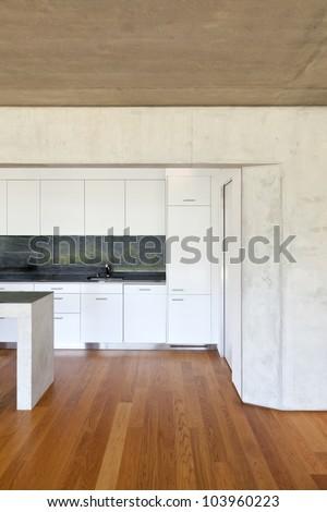 modern concrete house with hardwood floor, detail kitchen - stock photo