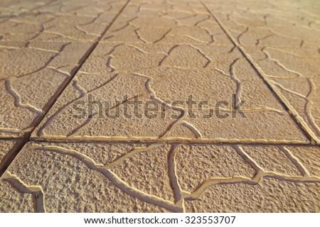 Modern concrete paving tiles of a garden path - stock photo