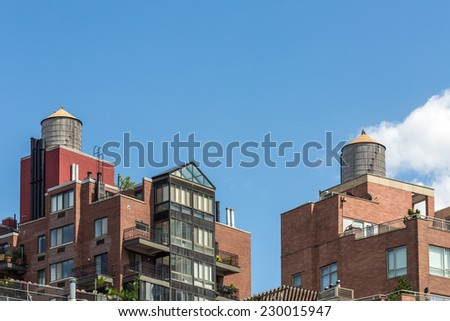 Modern Condo Buildings with water tank on top, New York, USA - stock photo