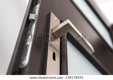 Modern, contemporary satin handle and keyhole detail - stock photo