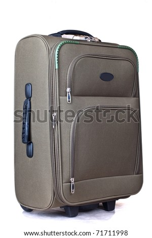 Modern convenient suitcase on castors on a white background - stock photo