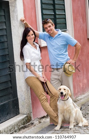 Modern couple with Labrador dog in the city - stock photo