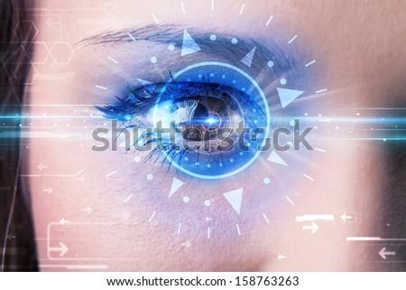 Modern cyber girl with technolgy eye looking into blue iris - stock photo