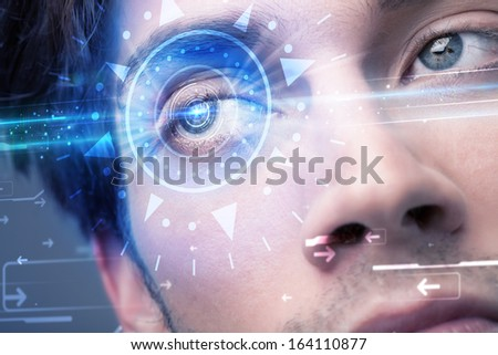 Modern cyber man with technolgy eye looking into blue iris - stock photo