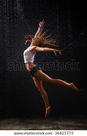 modern dancer posing in under water drop - stock photo