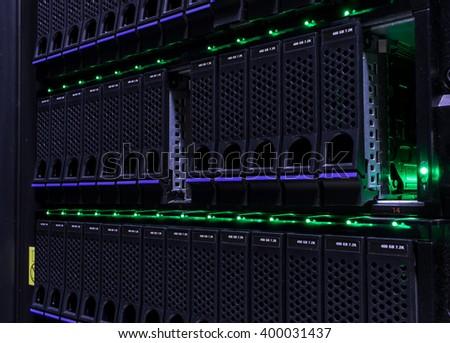 Modern data center disk storage perspective closeup - stock photo