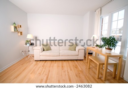modern day living room with beige couch - stock photo