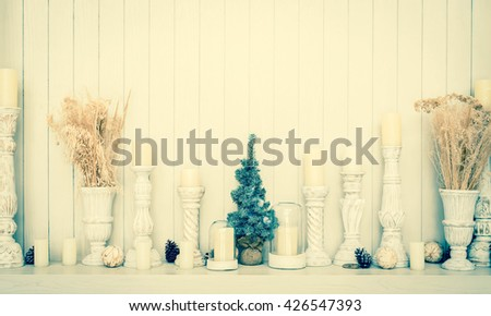 modern decoration on wooden background with copy space for montage your text.Vintage white wooden cabinet shelf with ornament - stock photo