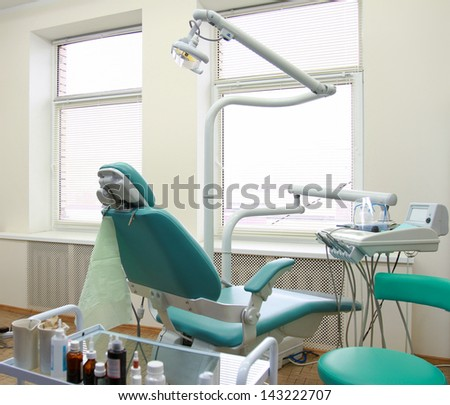 modern Dentist's chair in a medical room - stock photo