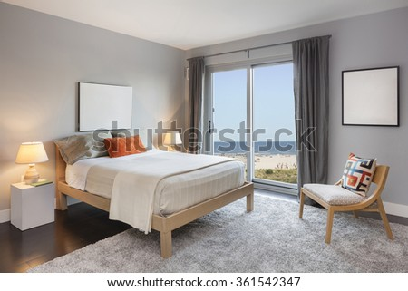 Modern Design Bedroom Interior with beach / ocean view. - stock photo