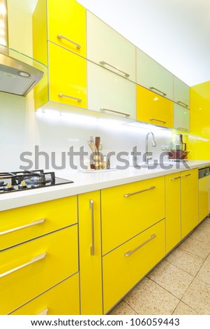 Modern design kitchen with yellow and green elements - stock photo