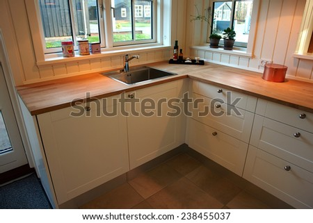 Modern design trendy kitchen with white and wood elements - stock photo