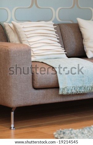 Modern designed sofa in blue and beige color - stock photo