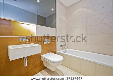 modern designer bathroom with white ceramic appliances - stock photo