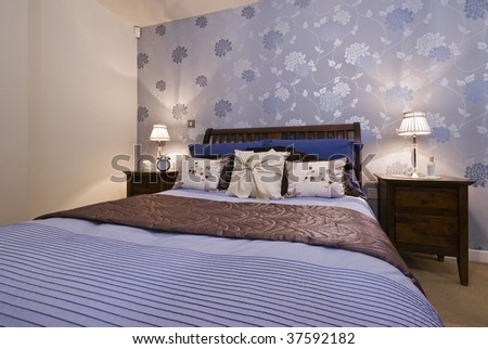 modern designer bedroom with amazing decoration and wallpaper - stock photo
