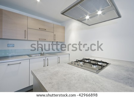 modern designer kitchen with separate work areas - stock photo