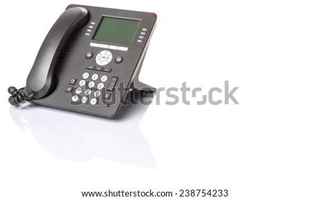 Modern desktop telephone over white background - stock photo