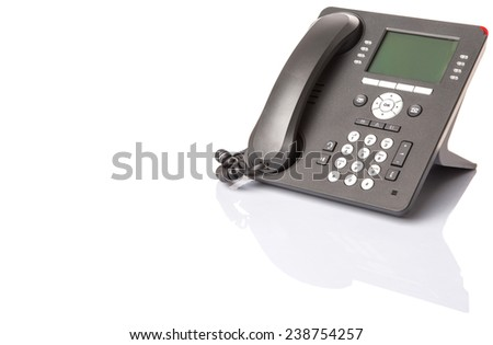 Modern desktop telephone over white background - stock photo