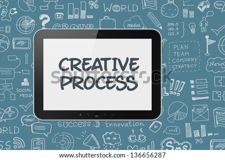 Modern digital tablet computer with creative process text on a screen. Hand drawn brainstorming doodles elements on a background. - stock photo