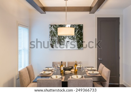 Modern dining room in luxury house. - stock photo