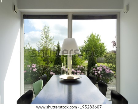 modern dining room with view to the garden - stock photo