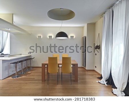 modern dining room with yellow leather chairs and wooden table, floor nade of parquet.  - stock photo