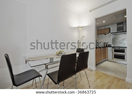 modern dining table with seats for six and open plan kitchen view - stock photo