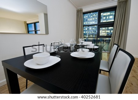 modern dining table with white leather chairs and setup - stock photo