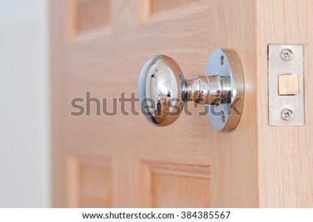 Modern door security on an interior wooden door - stock photo