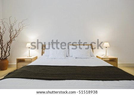 modern double bedroom with hard wood furniture - stock photo