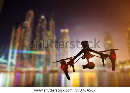 Modern drone in motion. Quadcopter with 4K camera flying. - stock photo