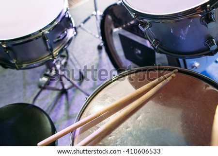 Modern drum set and drumsticks prepared for playing background top view. Flat lay professional drum kit  before a live concert. Drummer, music band, night show, sound recording concept - stock photo