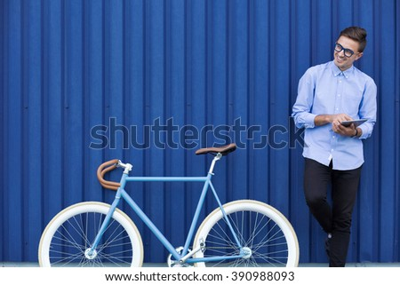 Modern ecological businessman with bicycle and tablet - stock photo