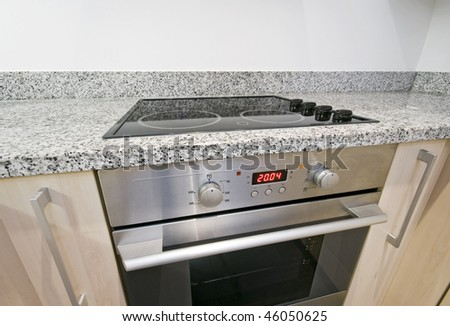 modern electric hob and oven detail shot - stock photo