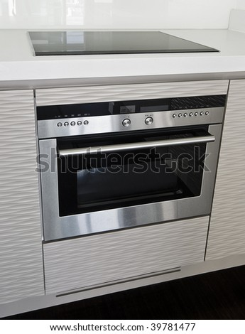 modern electric stove and oven in stainless steel finish - stock photo