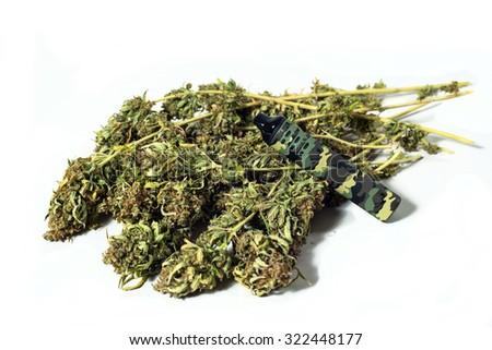 Modern electronic camouflage Cigarette E Cig Vaporizer and Cannabis plant isolated on white background - stock photo