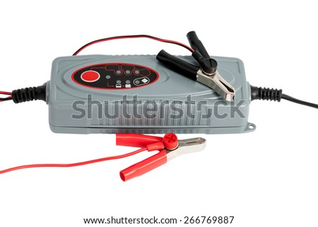 Modern electronic charger for car battery with clamps isolated on white background - stock photo