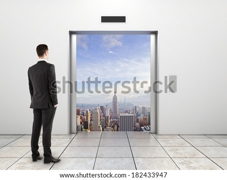 modern elevator with opened door to city - stock photo