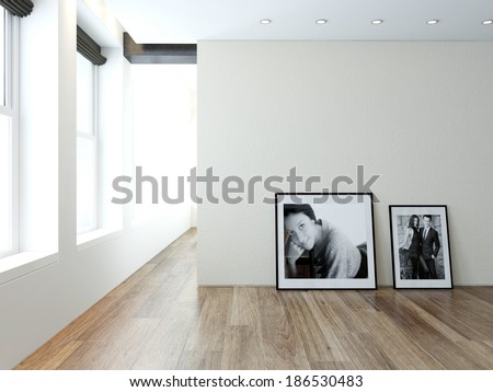 Modern empty room interior with pictures on wall - stock photo