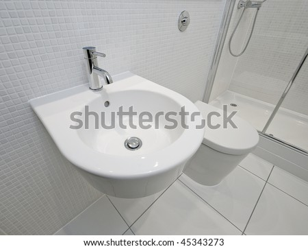 modern en-suite bathroom detail with white mosaic tiles - stock photo