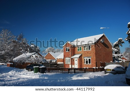 Modern English detached house in snow, taken during the big freeze in January 2010. Taken in Hampshire, England. - stock photo