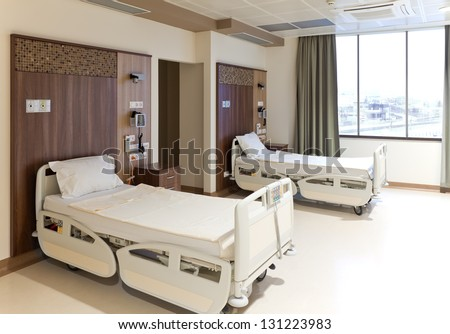 Modern equipped hospital room with two empty beds - stock photo