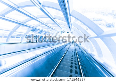 modern escalator with motion people - stock photo