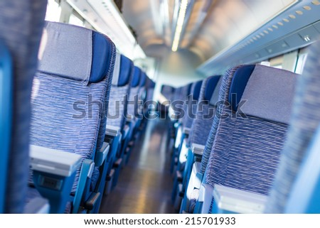 Modern european economy class fast train interior. Inside of high speed train compartment. - stock photo