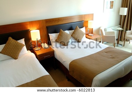 Modern Executive Hotel Bedroom - stock photo