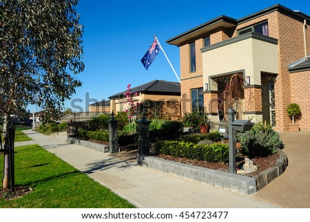 Modern family homes on a new street Melbourne Australia - stock photo
