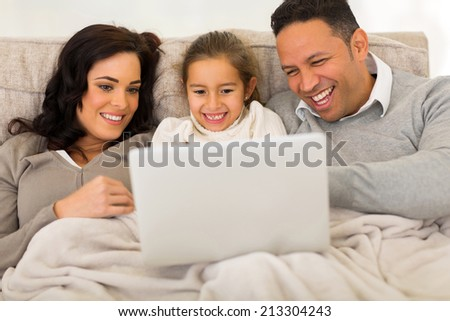 modern family using laptop computer at home - stock photo