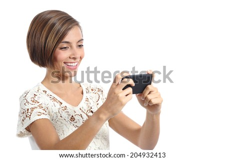 Modern fashion woman watching video in a smart phone isolated on a white background - stock photo